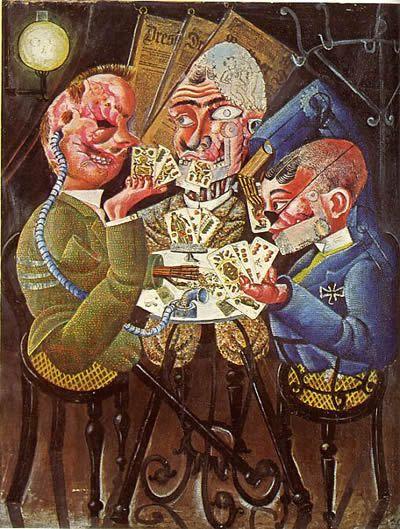 """Aux uniformes, on remarque un ancien combattant allemand (à droite), un britannique et un français... Ennemis d'hier... Mutilés et """"cassés"""" par la guerre, ils se retrouvent après la guerre à jouer aux cartes."""