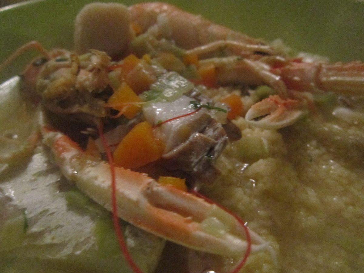 langoustines,  lieu noir coquilles st jaques en bouillon de légumes sur semoule de couscous
