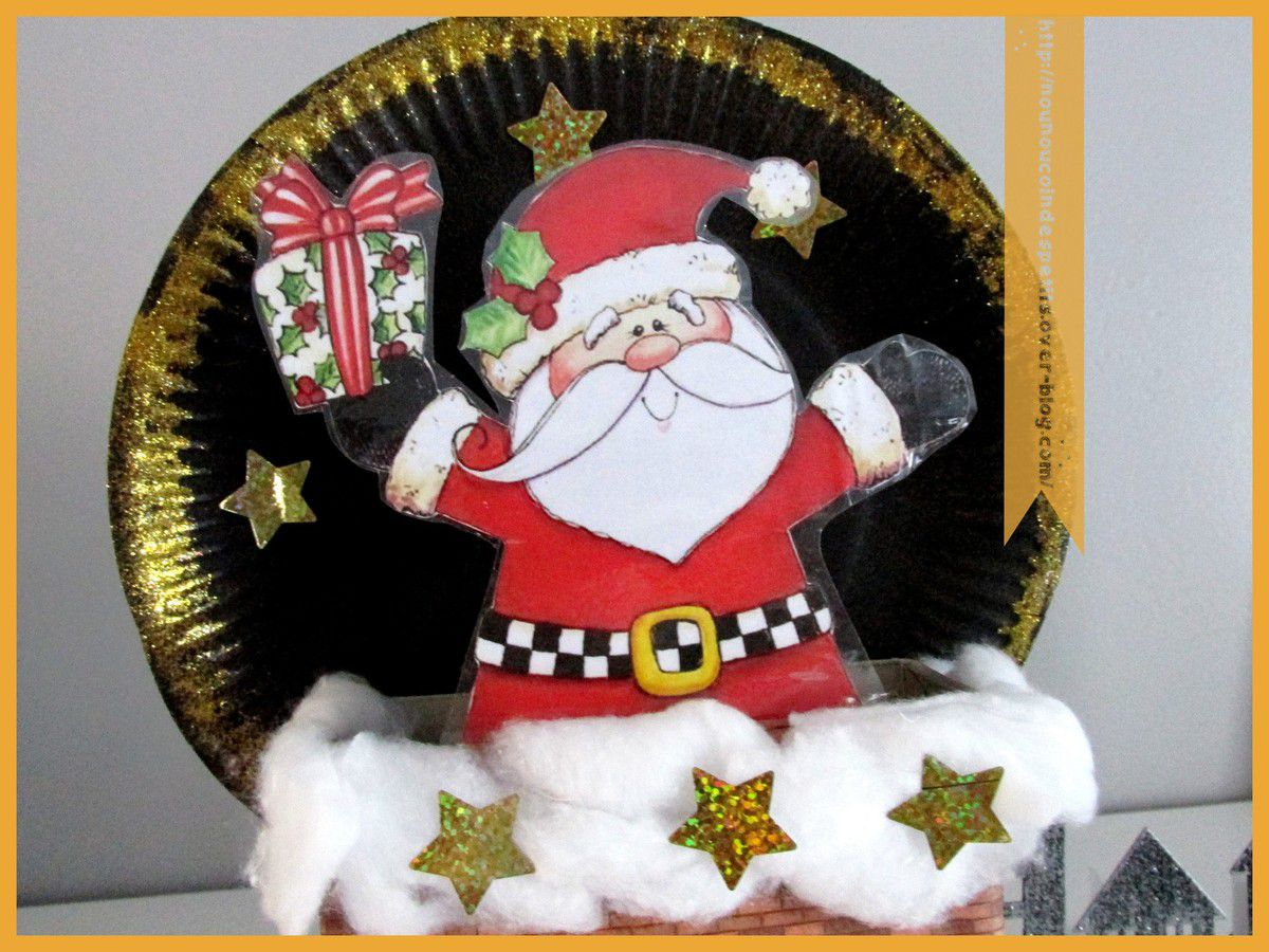 .. Père Noel range sucette en chocolat ..