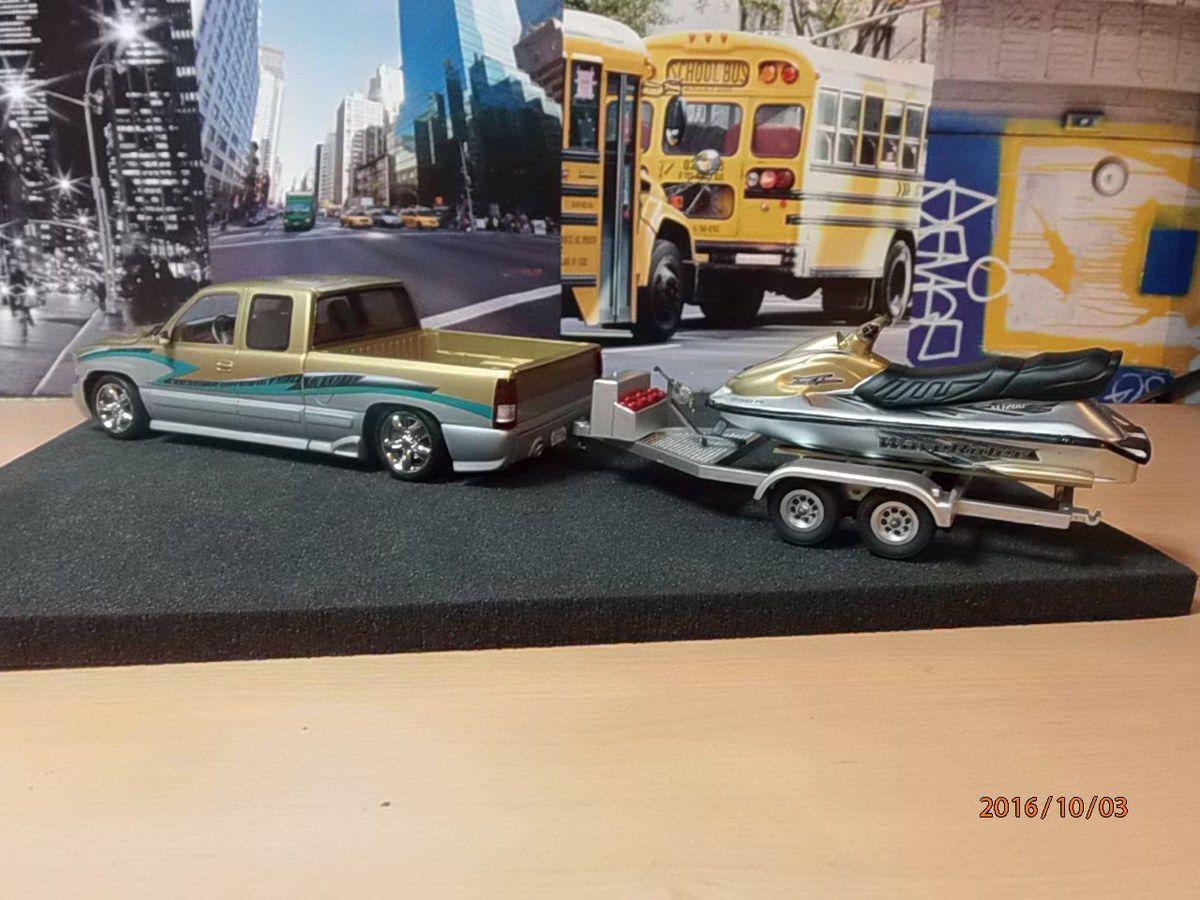 Custom Silverado and Wawerider boat     4/...