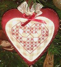 Cuoricini per San Valentino a broderie suisse