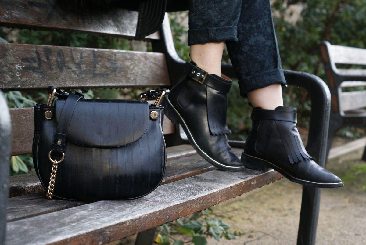 Veste H&M x Balmain - Chemise G-Star - Pull Un jour, un cachemire - Pantalon, bottines et sac Zara - Chapeau Los Angeles - Bagues Pull and Bear