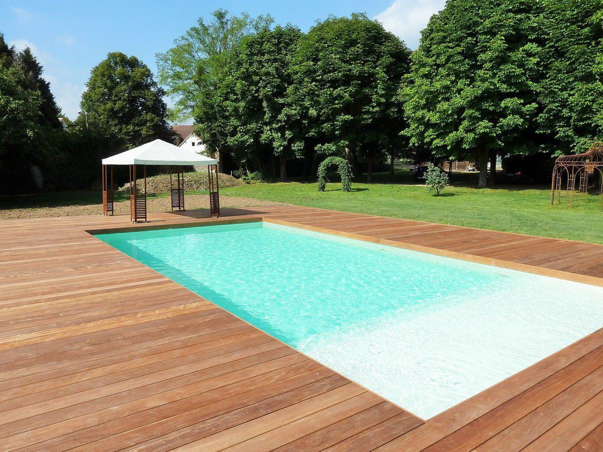 Terrasse bois autour piscine tubulaire for Conception de piscine