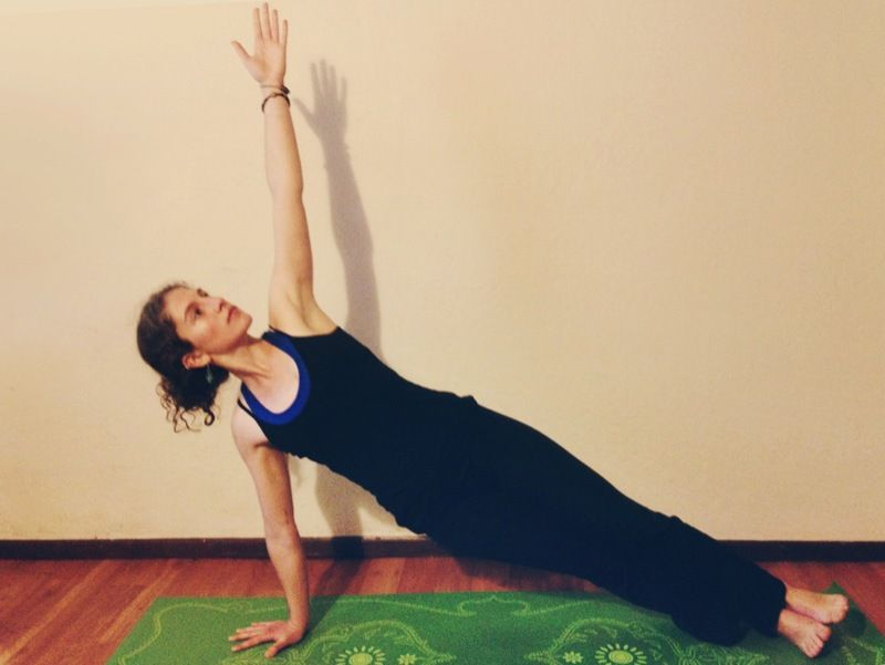11) Vasishtasana or sage pose:-  Benefits:-  →It works extensively on the shoulder, arms and the core muscles.  →It also improves flexibility and sense of balance.  Steps to do the pose:-  1)Lie down on your stomach. Bend your elbows and place your palms below your shoulders.  2)Now tuck you toes in and push the floor to straighten your elbows such that your upper body along with your pelvis is lifted off the floor. Make sure your body is in the same alignment as it was while you were lying down . 3)Now slowly twist your upper body to the left as you release your left hand from the floor.  4)Simultaneously turn your right foot to its outer edge and stack your left foot on the right foot.  5)Don't let your hips or pelvis drop. Hold it in the same alignment and as it was earlier.  6)Look up and stay in this position for five breaths.  7)Repeat the pose to the other side.