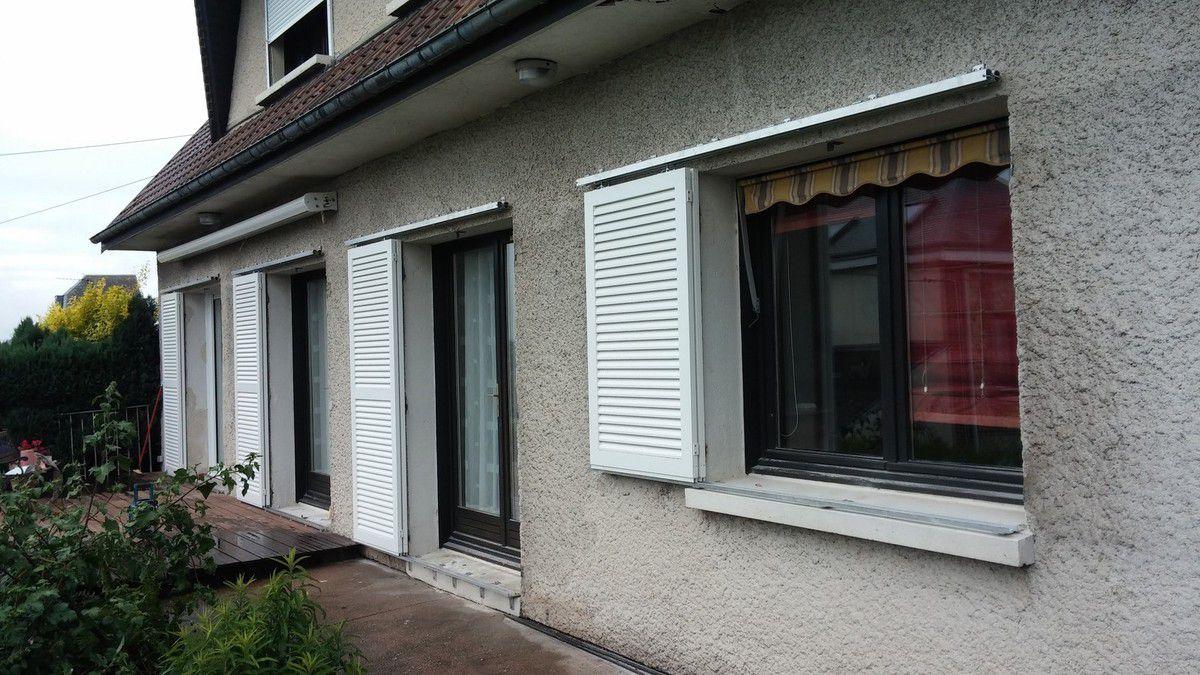 Pose de volets coulissants en aluminium dans la région de Rouen