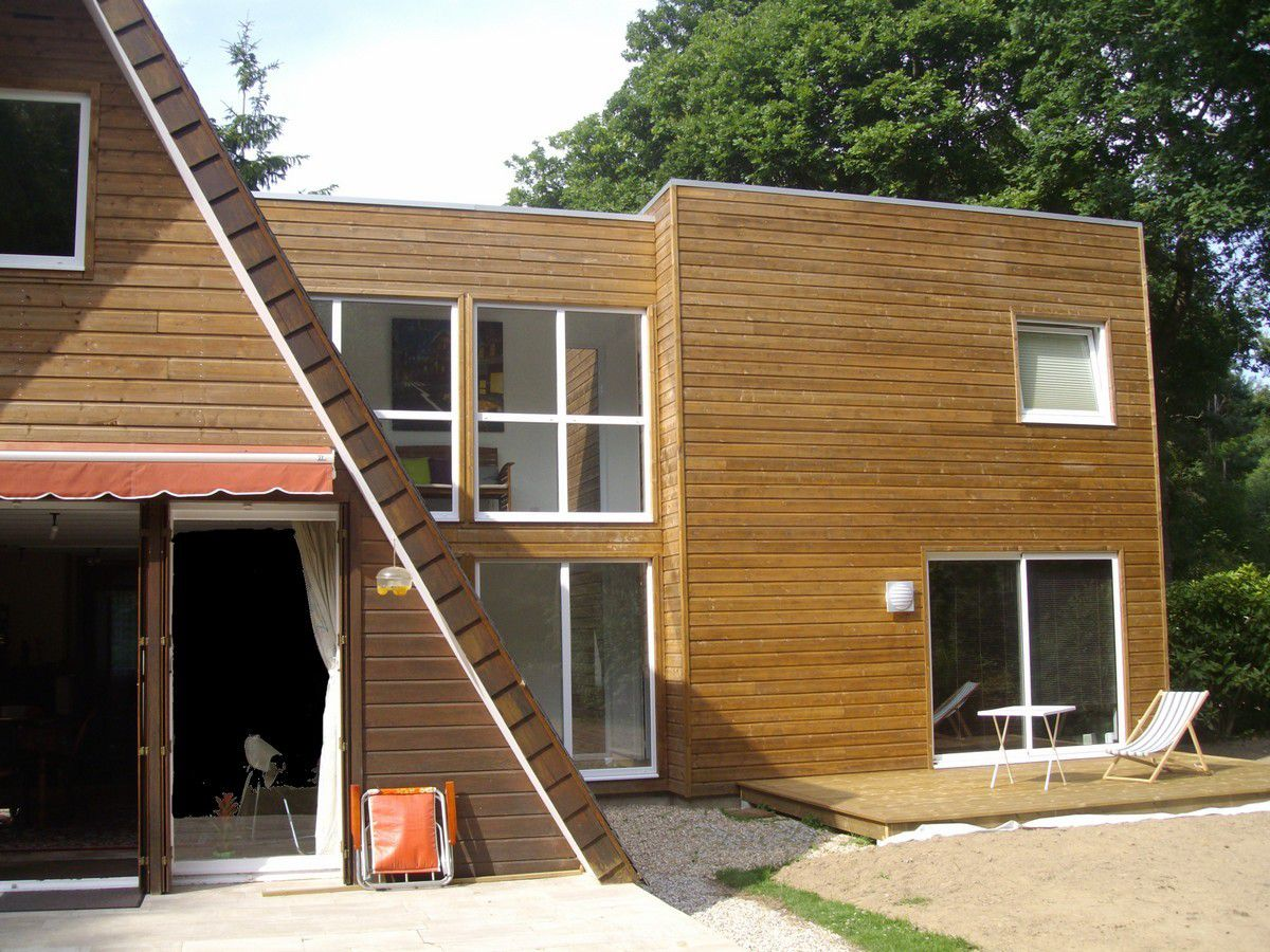 Extension d 39 une maison triangulaire en ossature bois les for Toiture extension maison