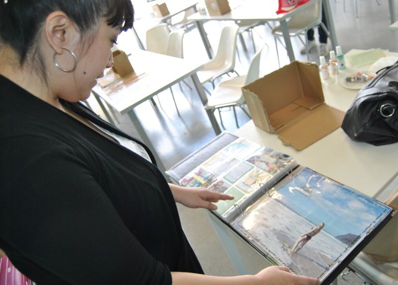 Ali showing me her PL album & the book we were going to make