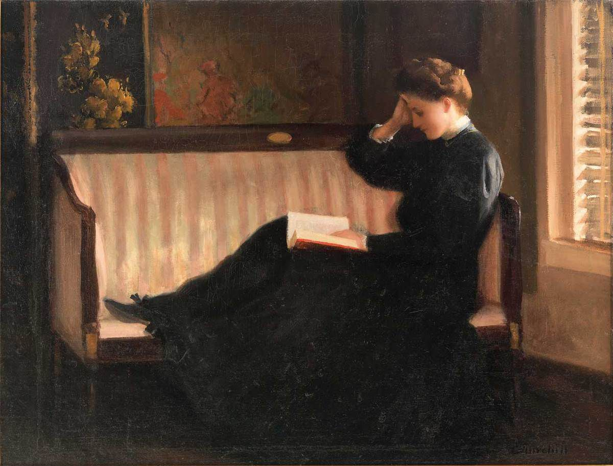 Churchill, William Worcester (1858-1926) -Woman reading in a settee c.1905-1910