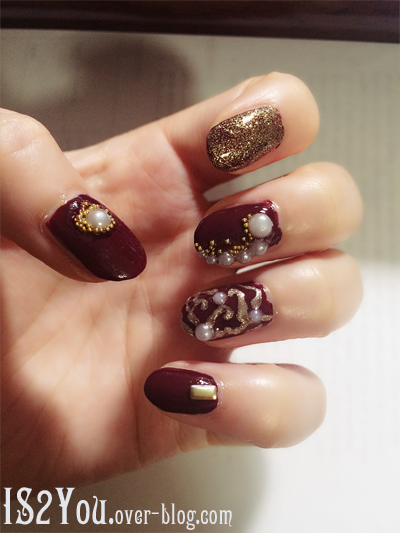 Burgundy nails with gold glitter and white pearls. Perfect for winter!