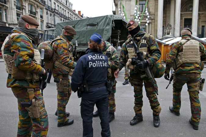 Belgian soldiers and police officers on patrol Tuesday in central Brussels. Credit Benoit Tessier/Reuters