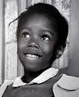 "A mural by Thierry Guetta, a photo of Ruby Bridges age 6 when she went to an integrated school and the painting by Norman Rockwell : ""the problem we all live with"" describing Ruby's first day at school."