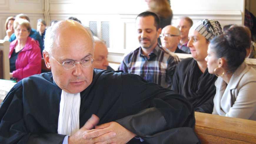 Marc et Samia Larère avec leur avocat, à l'audience du 9 octobre 2014. © Maxppp