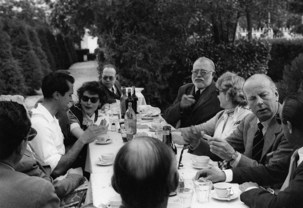Ava Gardner, Luis Miguel Dominguín, Ernest Hemingway, Mary Rupert Bellville and others at a luncheon at Costa dol Sol, Andalusia, Spain.