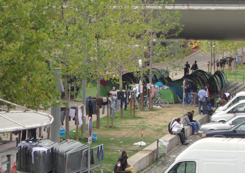 Migrants living in Paris refugee camp