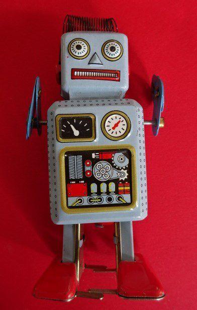 Petit robot bleu à remontoir mécanique, Cl. Elisabeth Poulain