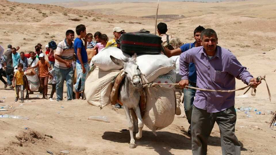 Refugiados sirios en el cruce Pesh Khabur en Dohuk (430 km al noroeste de Bagdad, Irak), Martes, 20 de agosto 2013  (AP / Hadi Mizban