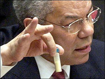 Colin Powell enseñando el ántrax y haciendo el signo 666