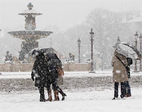 Et la neige sur Liège, pour neiger, met des gants...