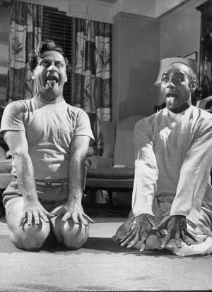 Yehudi Menuhin  & yogi Vithaldas (lion pose).  1953