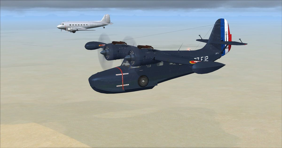 C'est au tour de F-Tikki, à bord de son DC3,de voler en formation avec le Grumman Goose...