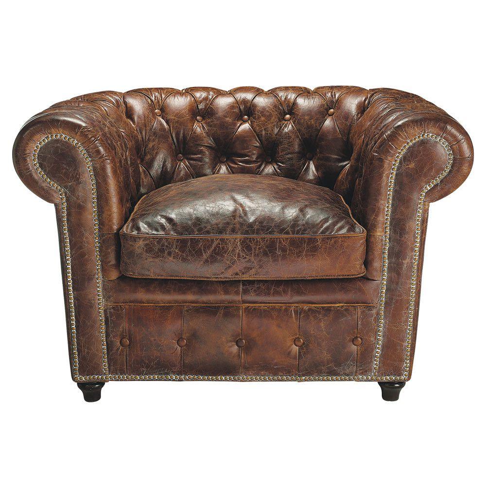 Fauteuil Chesterfield capitonné en cuir marron vintage.