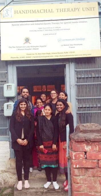 Raviraj and Jill with the Handimachal team, at the entrance of the Handimachal Therapy Unit.
