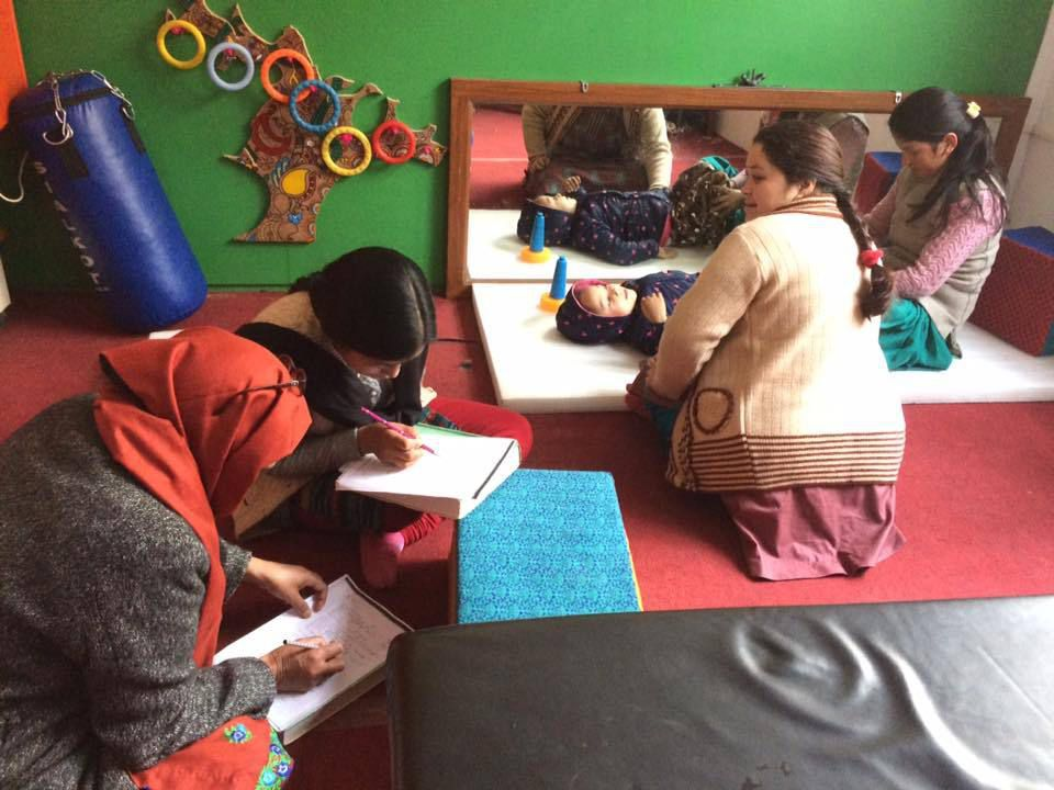 Physical rehabilitation training by Rekha (with a child and mother)