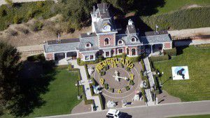 LOS OLIVOS, CA - NOVEMBER 18 :  An aerial photo shows a Santa Barbara County Sheriff's vehicle in front of singer Michael Jackson's Neverland Ranch November 18, 2003 outside of Santa Barbara, California. Police armed with a search warrant swarmed Jackson's sprawling home in the Santa Ynez Valley. One media report said the warrant was tied to allegations brought by a 12-year-old boy.  (Photo by Frazer Harrison/Getty Images)