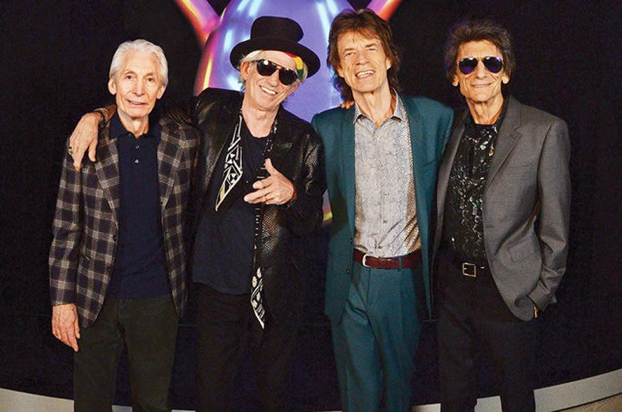 Charlie Watts, Keith Richards, Mick Jagger and Ronnie Wood of The Rolling Stones pose for a photo during a preview of 'The Rolling Stones: Exhibitionism' at Saatchi Gallery on April 4, 2016 in London