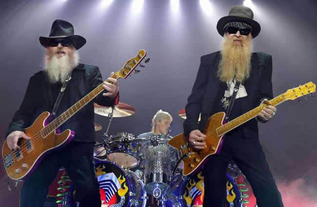 """ZZ Top bassist Dusty Hill (left) and guitarist Billy Gibbons perform on June 9, 2009 in Munich, Germany, during their """"ZZ Top European Tour 2009."""""""