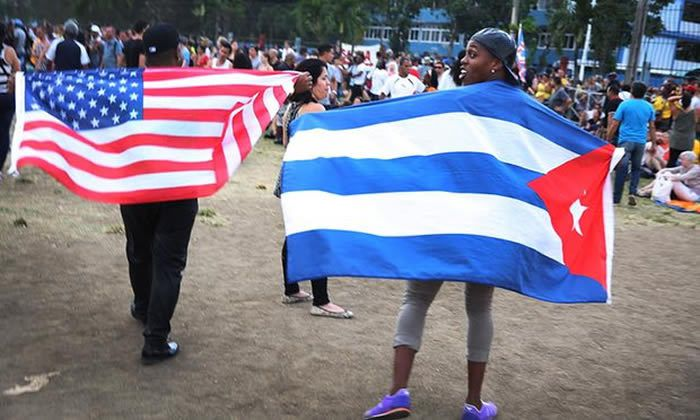 Rolling Stones fans sporting US and Cuban flags at the Ciudad Deportiva ground. Photograph: Joe Raedle/Getty Images