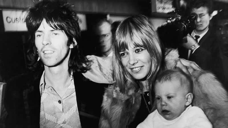 Rolling Stones guitarist Keith Richards is reunited with girlfriend with Anita Pallenberg and their son, Marlon on his arrival at London Airport (now Heathrow) from the U.S. on Dec. 8, 1969. (Daily Express/Getty Images)