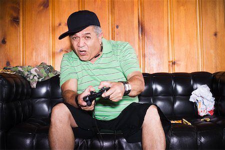 Man Playing Video Games Stock Photo - Rights-Managed