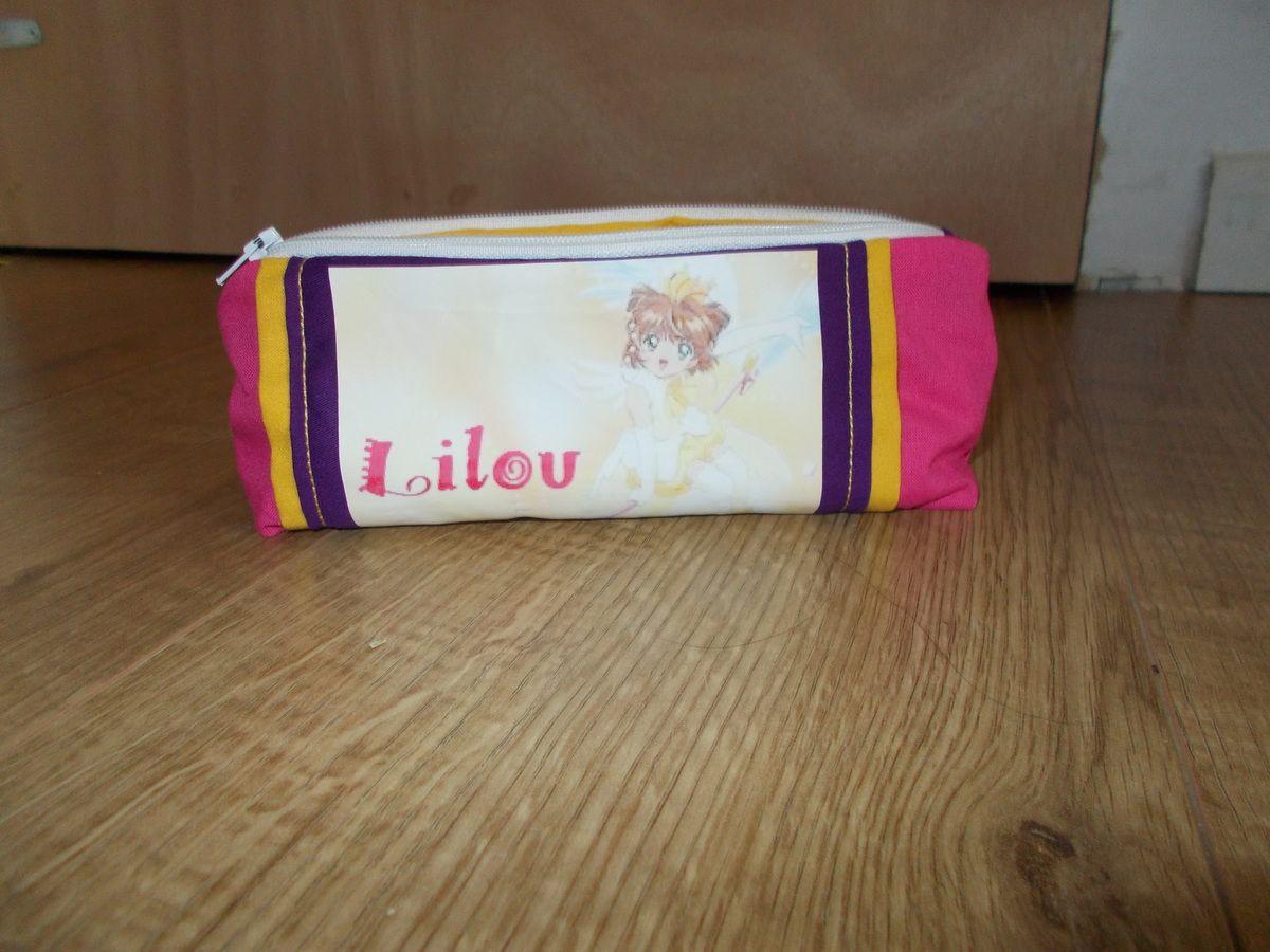 la trousse de Lilou rose jaune et violette. avec doublure jaune