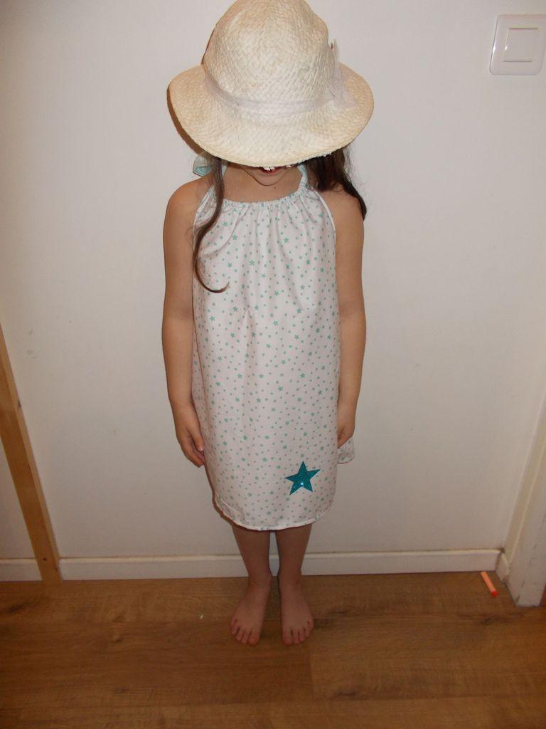 robe avec le petit modele dedans!! Les deux versions du dos