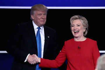 HEMPSTEAD, NY - SEPTEMBER 26: (L-R) Republican presidential nominee Donald Trump and Democratic presidential nominee Hillary Clinton shake hands after the Presidential Debate at Hofstra University on September 26, 2016 in Hempstead, New York. The first of four debates for the 2016 Election, three Presidential and one Vice Presidential, is moderated by NBC's Lester Holt. Credit: Drew Angerer / Staff
