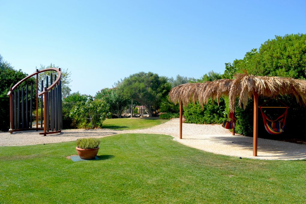 "THE GARDENS -  Are set on one hectar of land providing several diferent relaxation areas such as the unique "" ARCH of SOUND "" , pathways for walks with water streams, green areas and a lake."