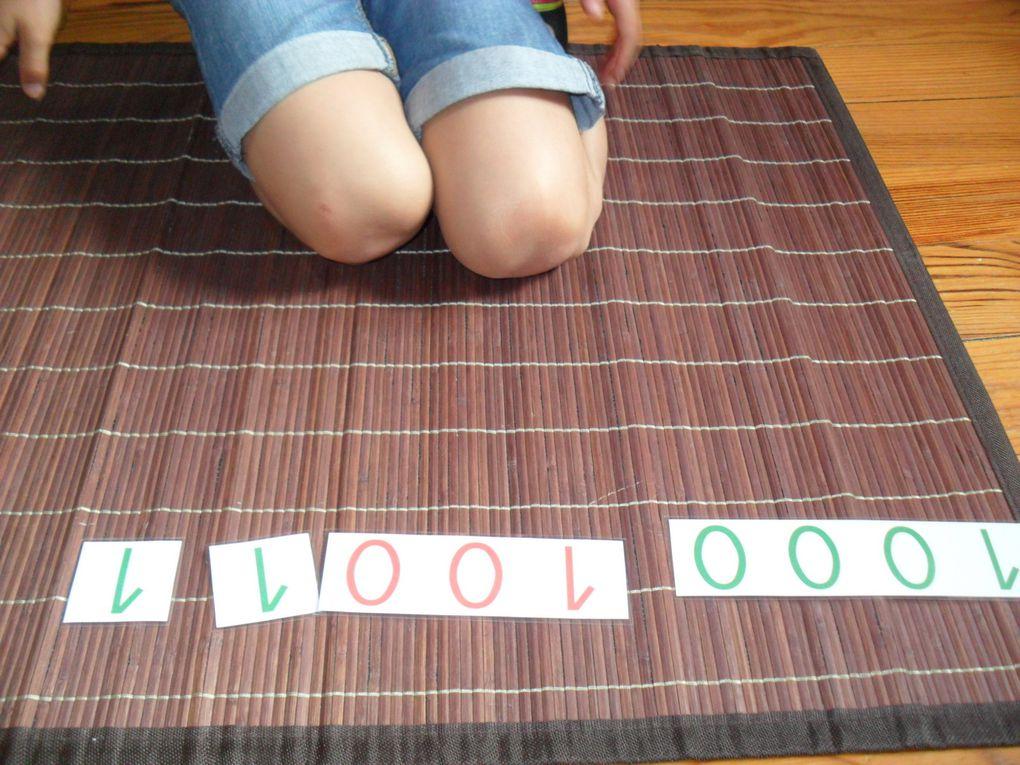 Apprentissage du système décimal et magie des nombres.