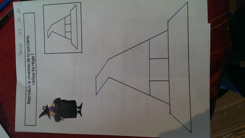 Reproduction de figures à la règle et symétrie.