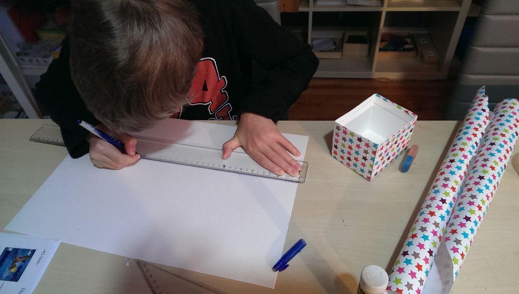 Lucas a voulu fabriquer des boîtes cadeaux. Il a fait les plans pour que ses frères et soeurs puissent aussi faire leurs boîtes.