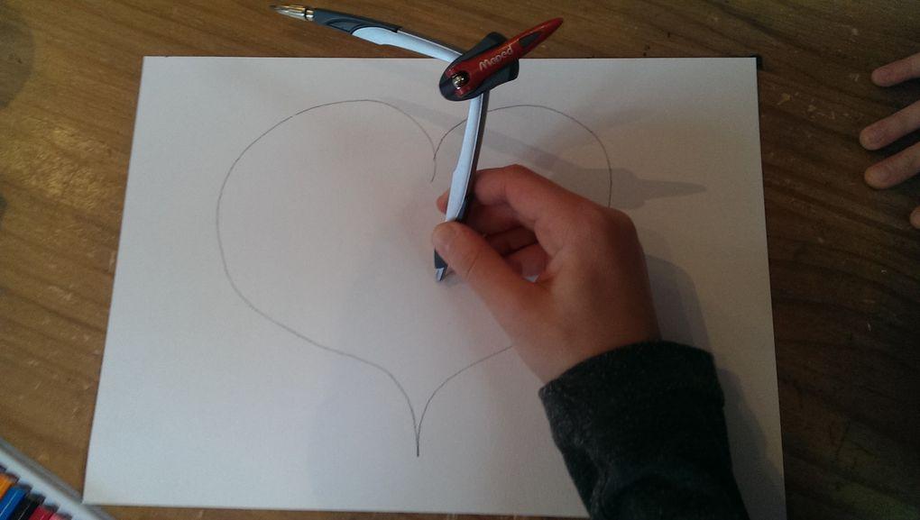 Les enfants ont ensuite fabriqué leurs propres Op arts en dessinant un coeur puis en traçant des cercles au compas. Le but étant de varier les couleurs : couleurs chaudes pour l'intérieur du coeur et couleurs froides pour l'extérieur (pas évident à comprendre pour les enfants).