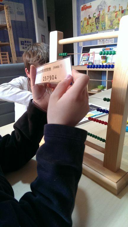 Lecture de grands nombres avec le boulier.