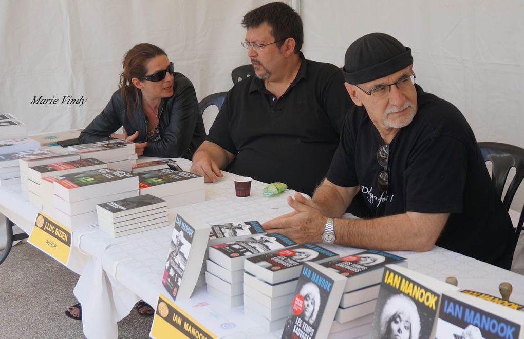 Cliquez sur la flèche (droite-gauche) pour faire défiler : Franck Bouysse / Ida Mesplède avec JG Arnaud / J G Arnaud / Prix Sable Noir / Tables rondes