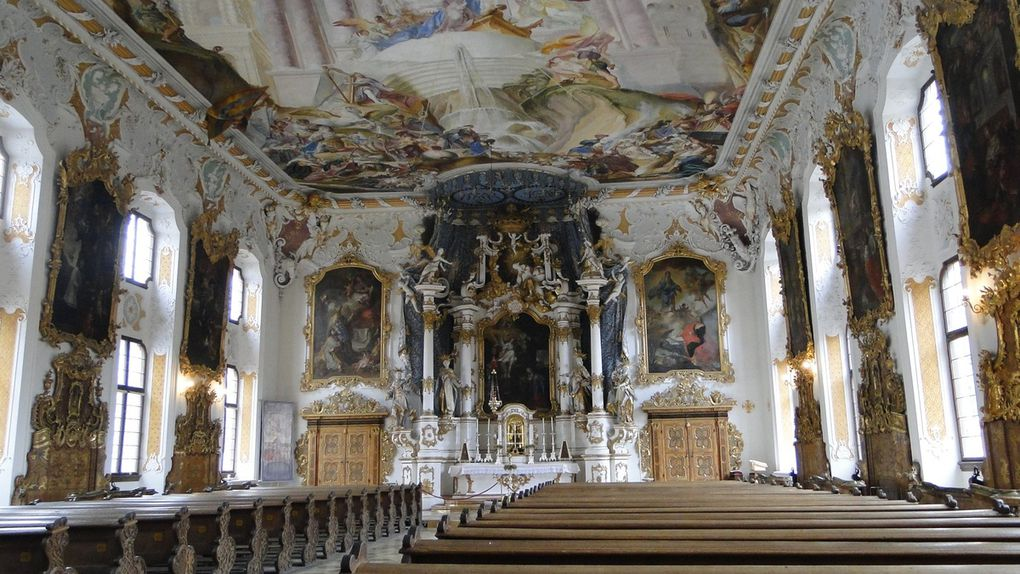 Zu den bekanntesten Werken Fischers zählt das Schnitzwerk am Hochaltar der Asamkirche in Ingolstadt (Kongregationskirche Maria de Victora), ein barockes Schatzkästchen. In den Hochaltar von 1759 fügen sich das Altarbild von 1675, der Stuckbaldachin von 1734, der Altaraufbau und die Patrone der vier Fakultäten (Cosmas für die Medizin, Thomas von Aquin für die Theologie, Ivo für die Jurisprudenz und die hl. Katharina von Alexandrien für die Philosophie) sowie die heiligste Dreifaltigkeit im Auszug  - alles Schnitzwerk von Johann Michael Fischer aus Dillingen um 1763 - zur Einheit.