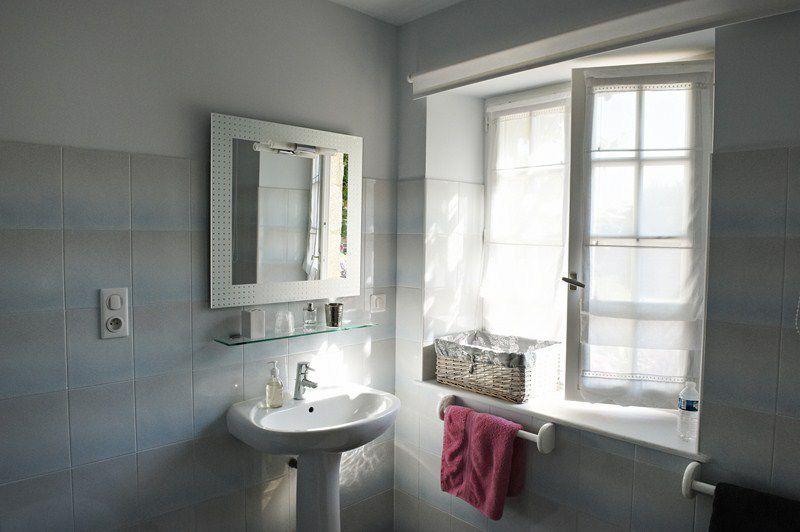 Rénovation d'une salle de bain : moderniser et éclairer
