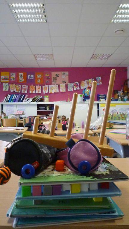 """Nous avons étudié l'oeuvre d'Arcimboldo - """"Le bibliothécaire"""" puis, par groupe, les élèves ont construit leur portrait d'écolier à l'aide du matériel qu'ils utilisent au quotidien dans la classe."""
