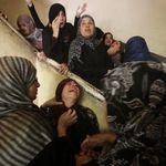 Relatives of Palestinian  Abduallah El-Buhasi, who was killed in an Israeli air strike