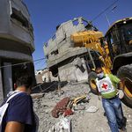 Red cross staff arrive to the damaged area in Al Shejaeiya neighbourhood