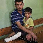 Palestinian Ibrahim Imtawak, 30, holds his son Muhammed, 4, at the Kamal Adwan hospital in Beit Lahiya,