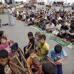 Displaced Palestinians attend the morning Eid al-Fitr prayer at an United Nations (UN) school in Jabalia